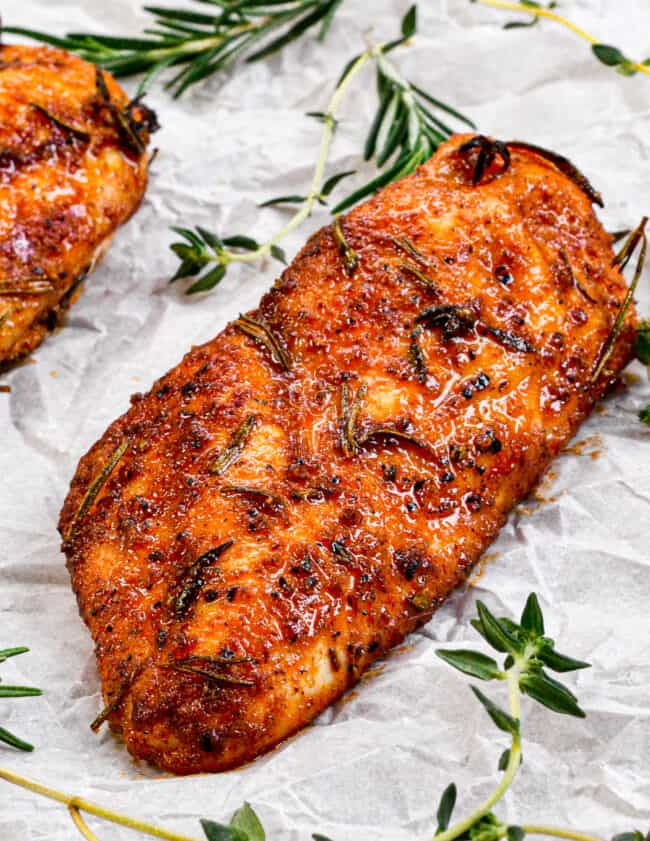 juicy baked chicken breasts on parchment