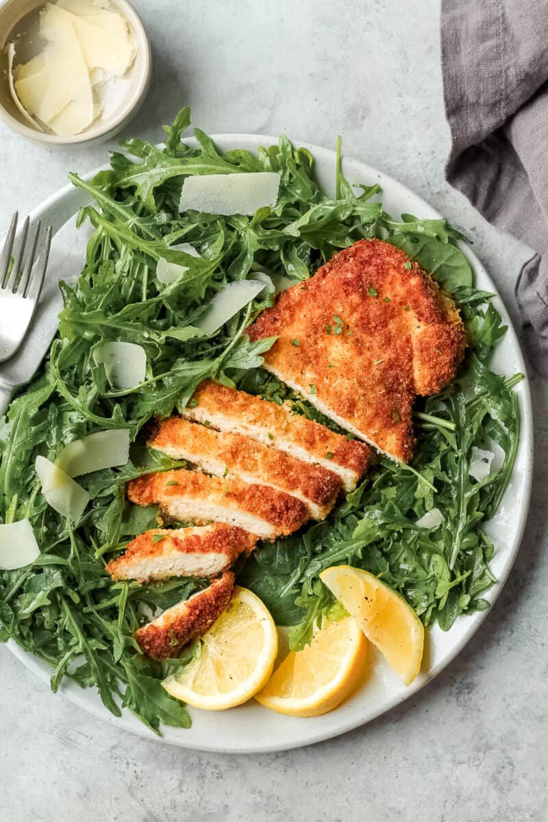 chicken milanese on plate with salad