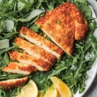 up close image of chicken milanese sliced and breaded