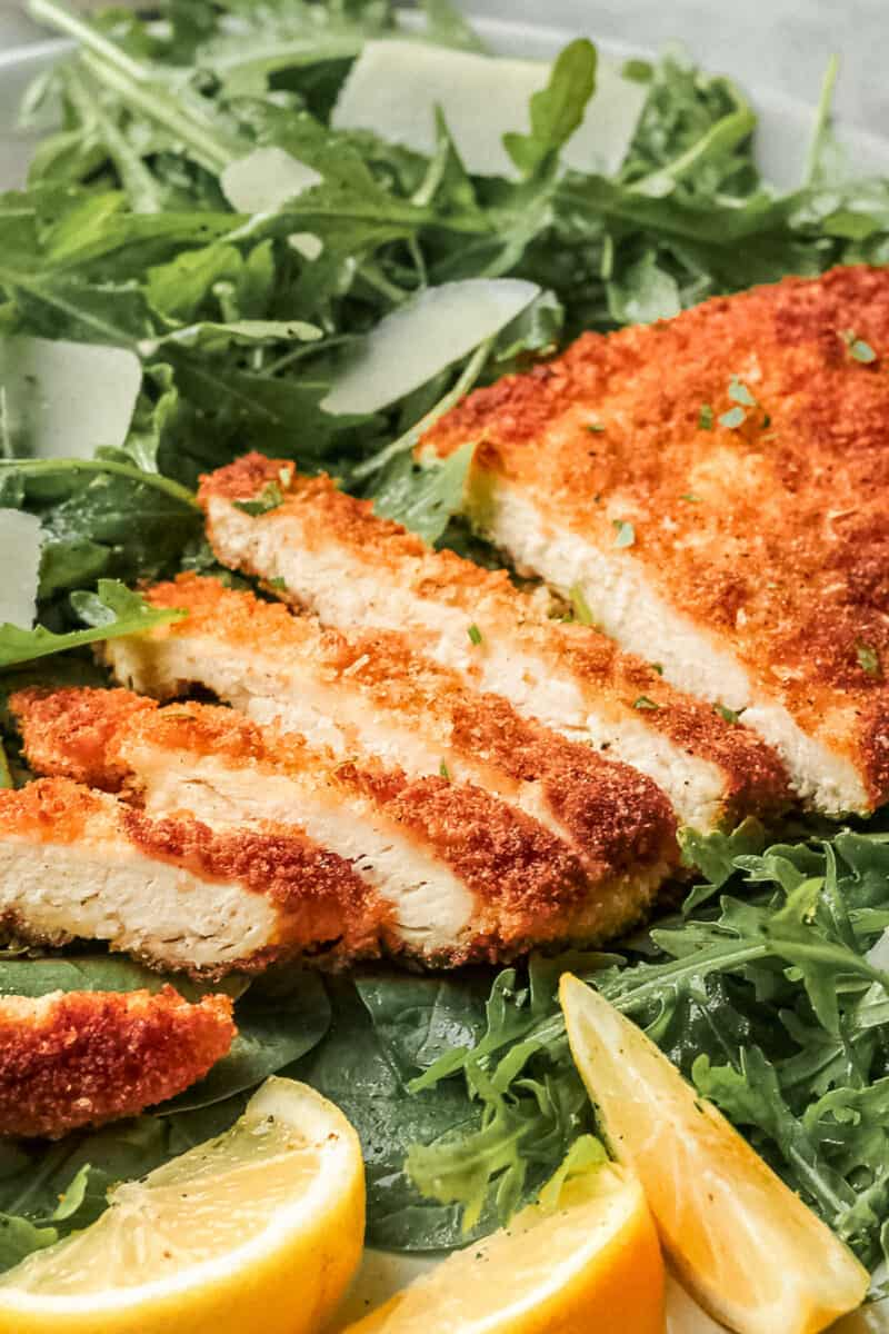up close image of sliced chicken milanese