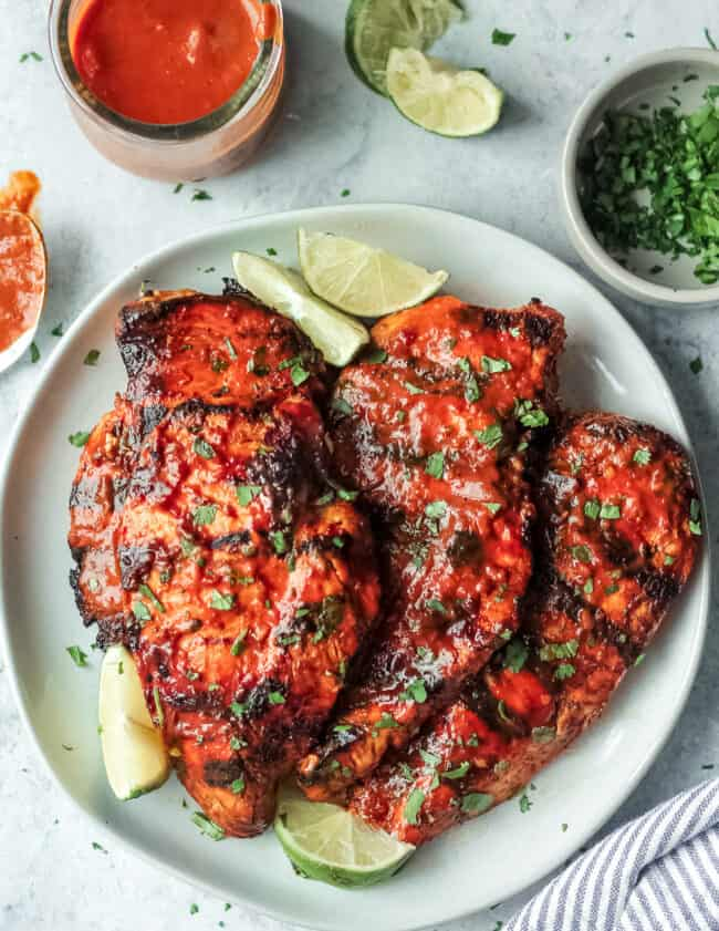 grilled chipotle chicken on plate with limes