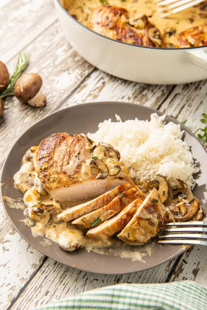 sliced chicken in mushroom sauce on plate