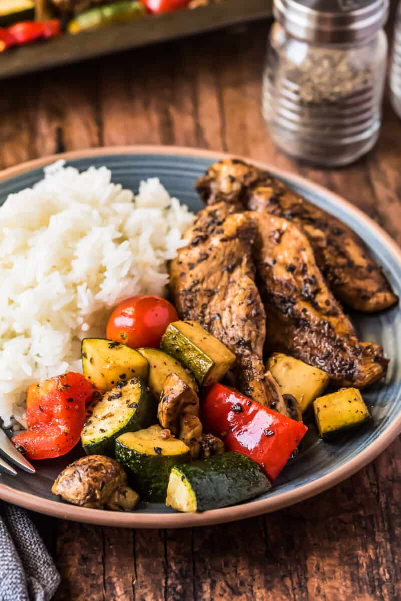 plated balsamic chicken with vegetables and rice