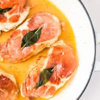 up close overhead image of chicken saltimbocca in stock pot