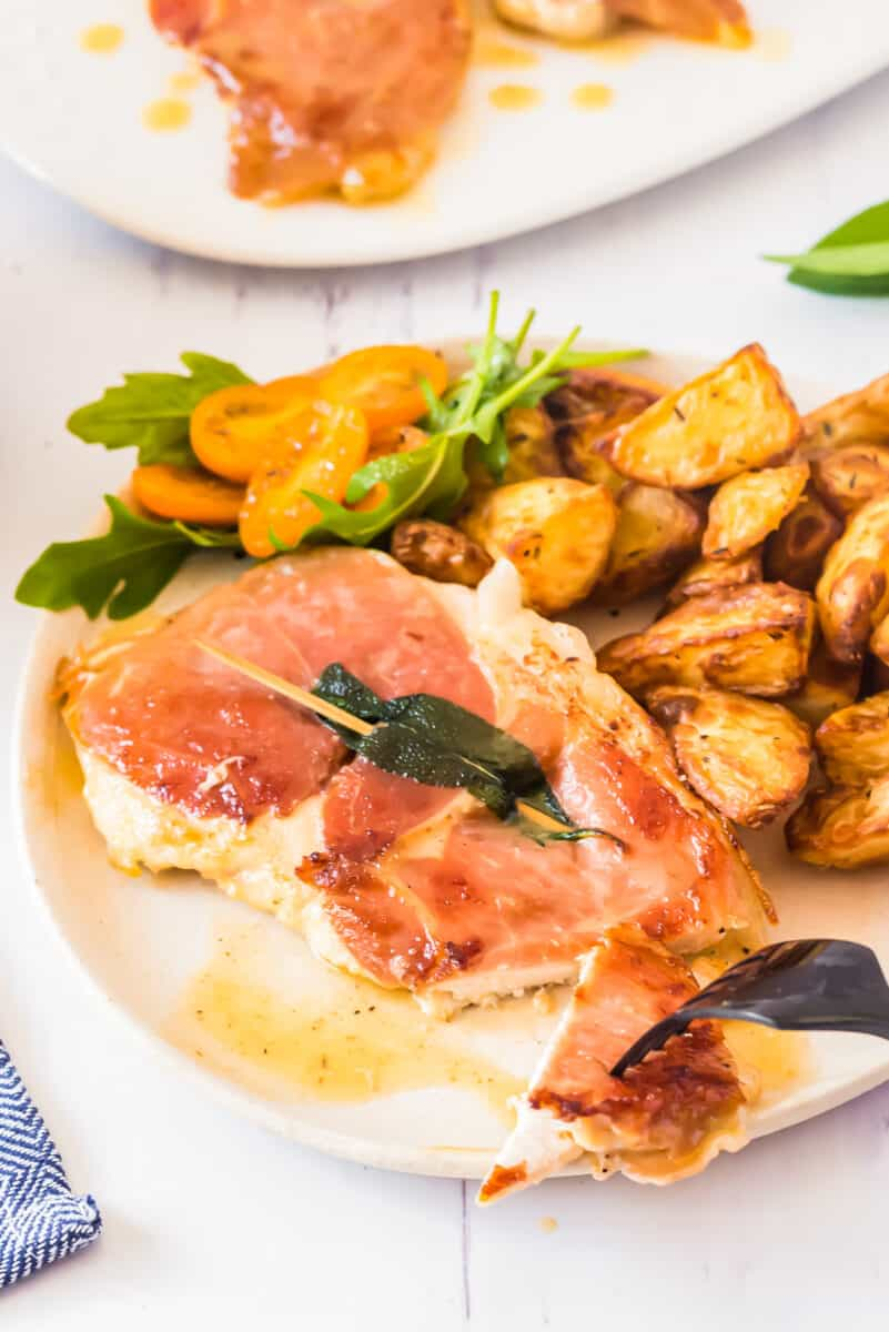 plate with chicken saltimbocca and potatoes