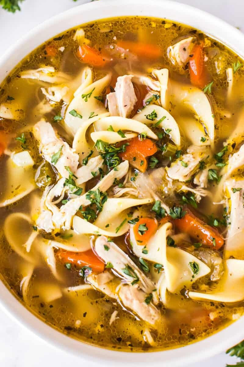 up close image of instant pot chicken noodle soup in bowl