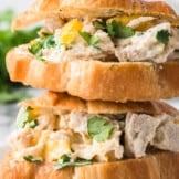 up close image of mango chicken salad sandwich on croissant