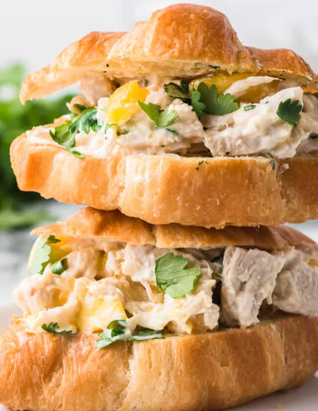 up close image of mango chicken salad sandwich on croissant