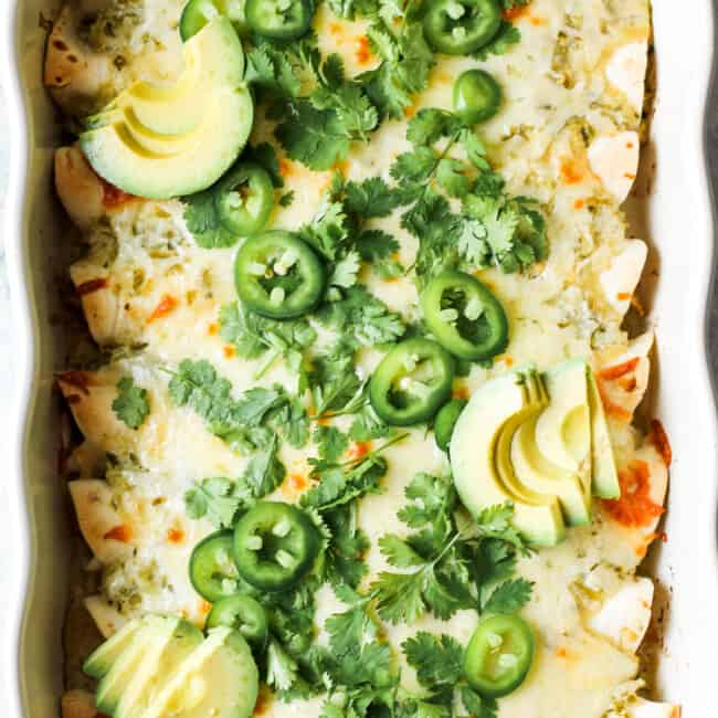 green salsa verde enchiladas topped with jalapenos