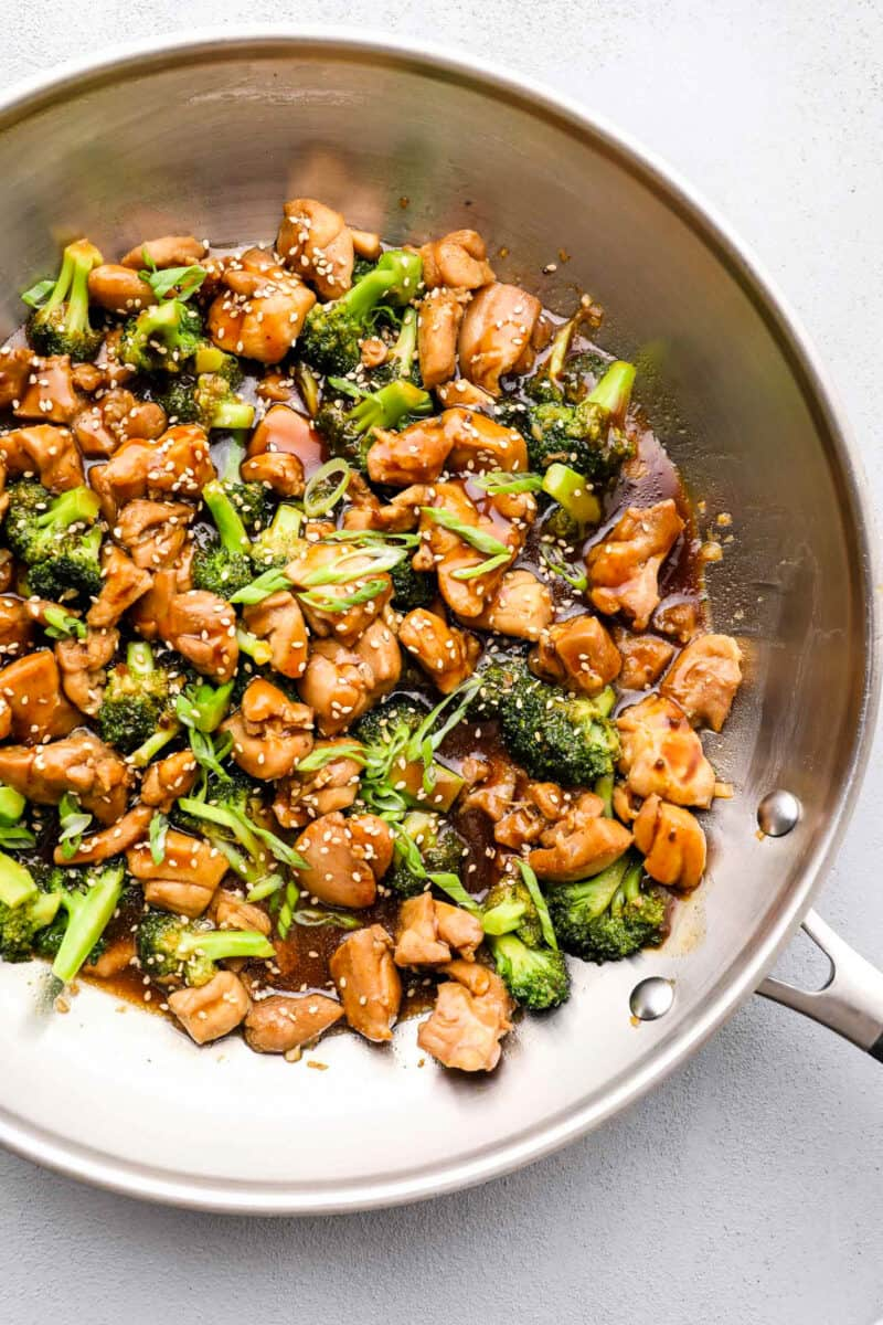 teriyaki chicken thighs and broccoli in skillet
