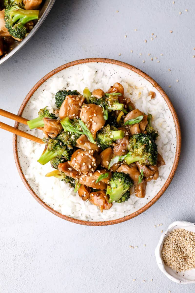 plate of teriyaki chicken and rice with broccoli