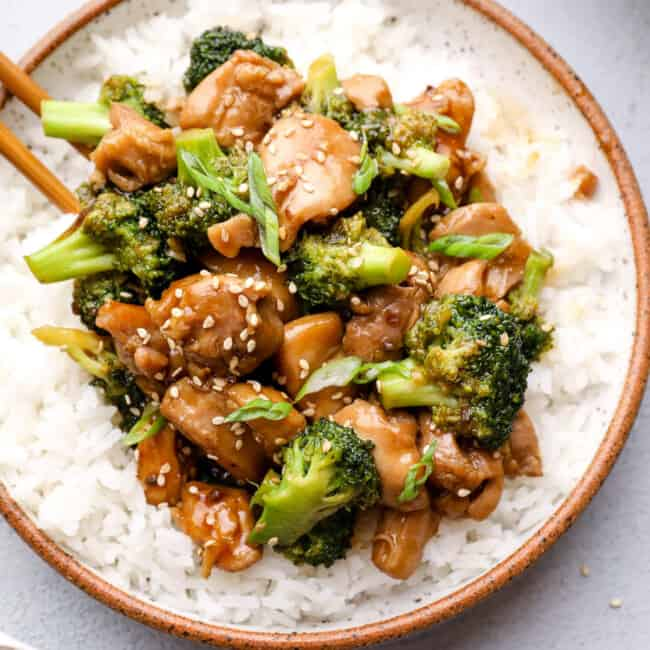 overhead image of teriyaki chicken thighs with broccoli and rice