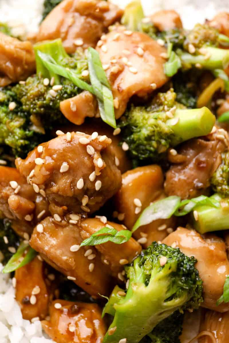 up close image of teriyaki chicken thighs garnished with sesame seeds