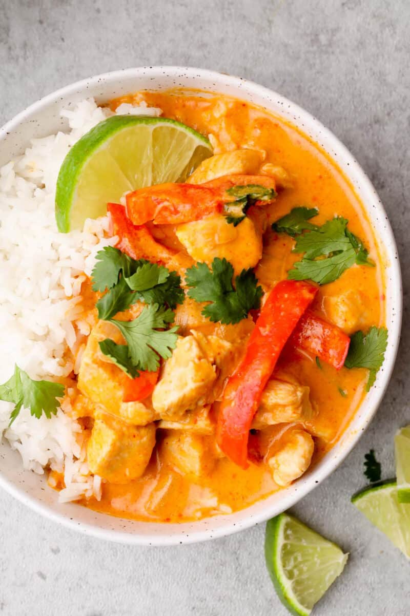 overhead image of thai red curry chicken in bowl with rice