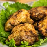 air fried chicken thighs on bed of lettuce