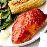 white plate with apple cider bbq chicken