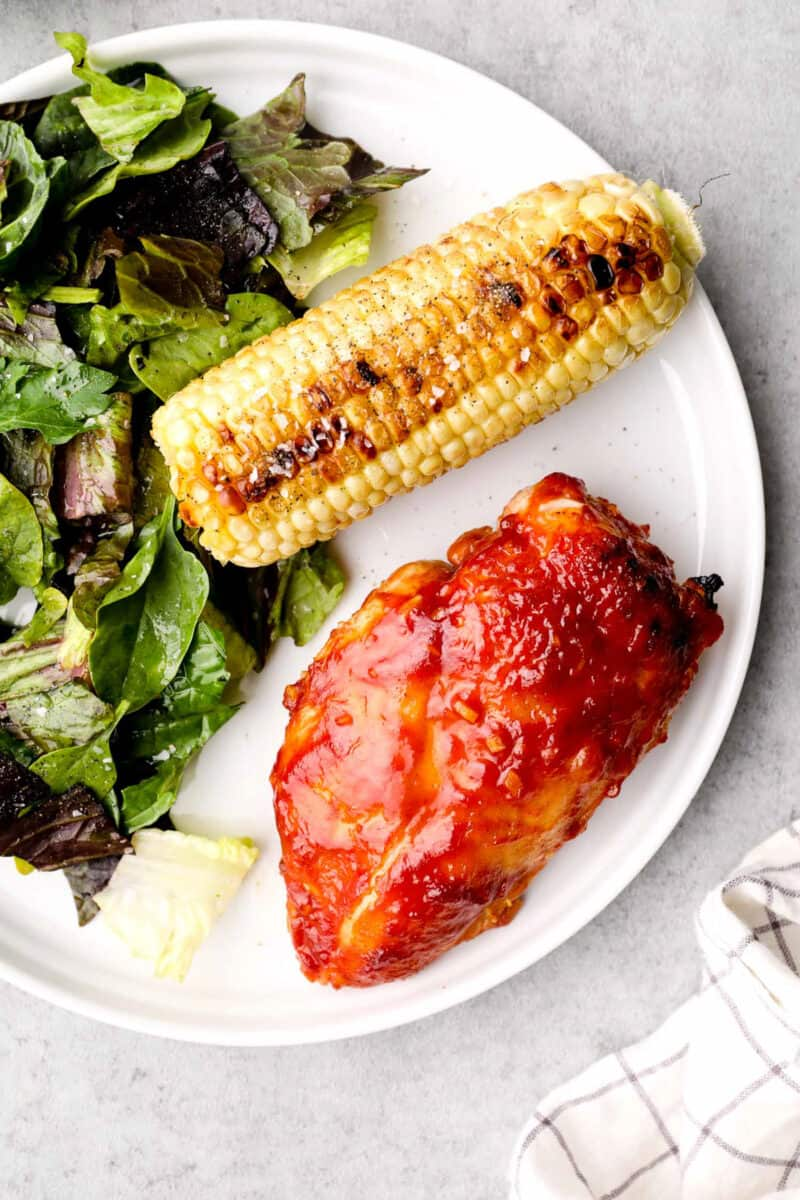 apple cider bbq chicken with corn and salad