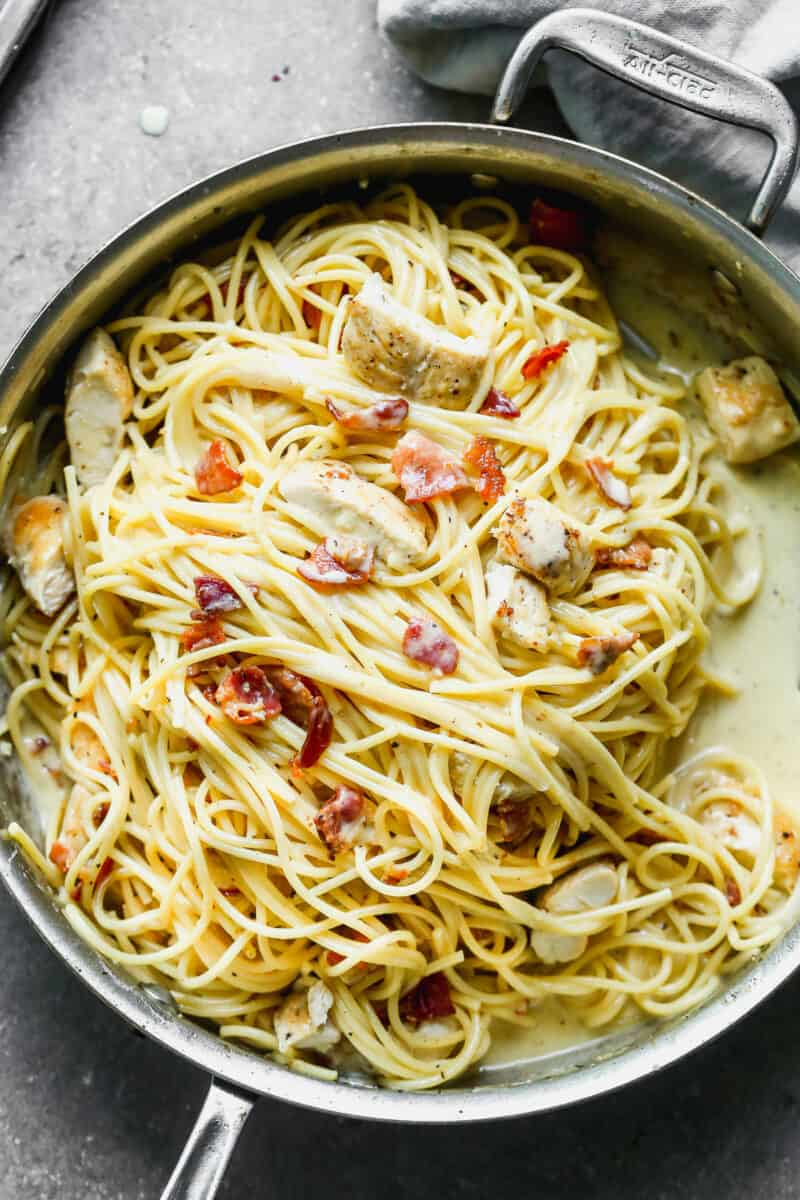 creamy chicken carbonara pasta in skillet