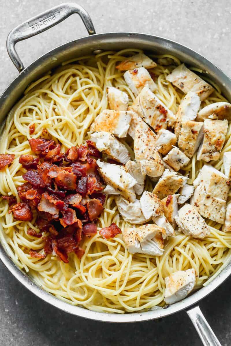 separated ingredients for chicken carbonara in skillet