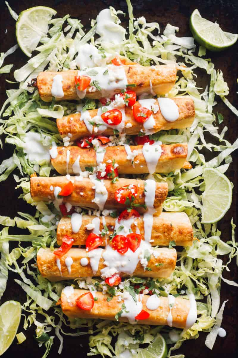 fried chicken flautas on bed of lettuce