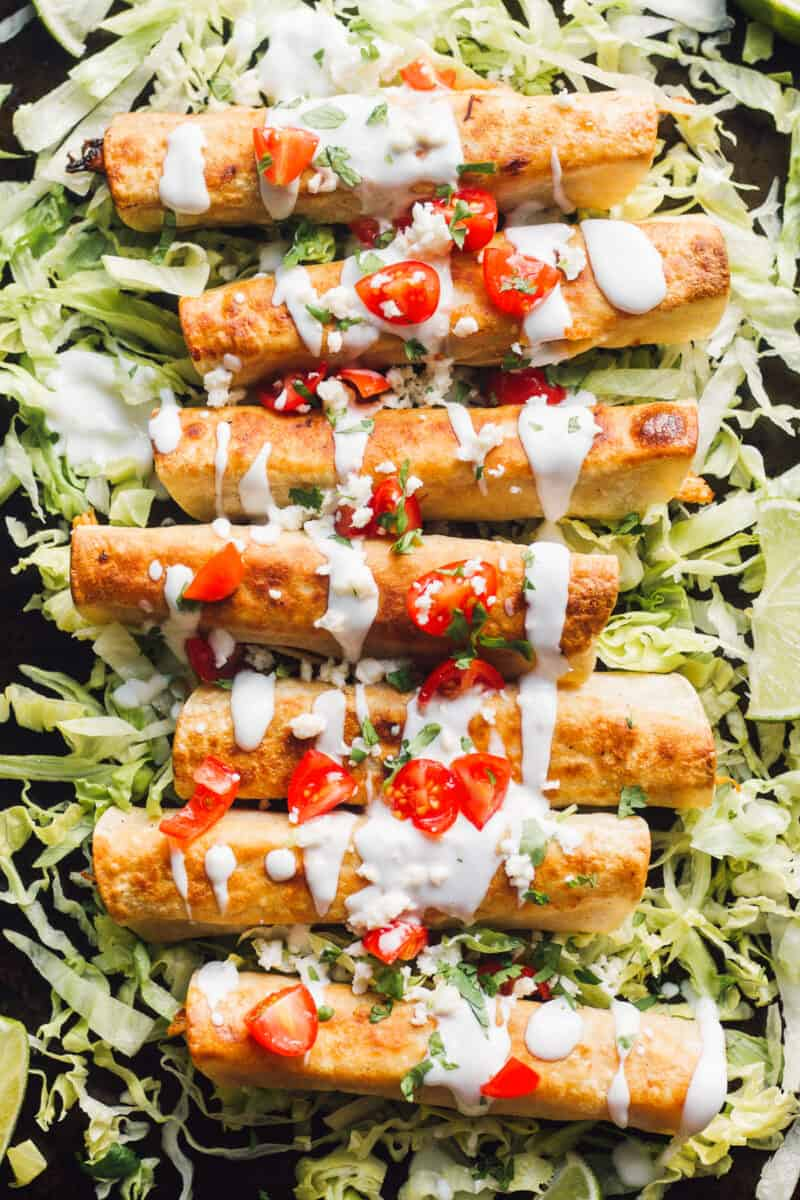 fried chicken flautas on lettuce