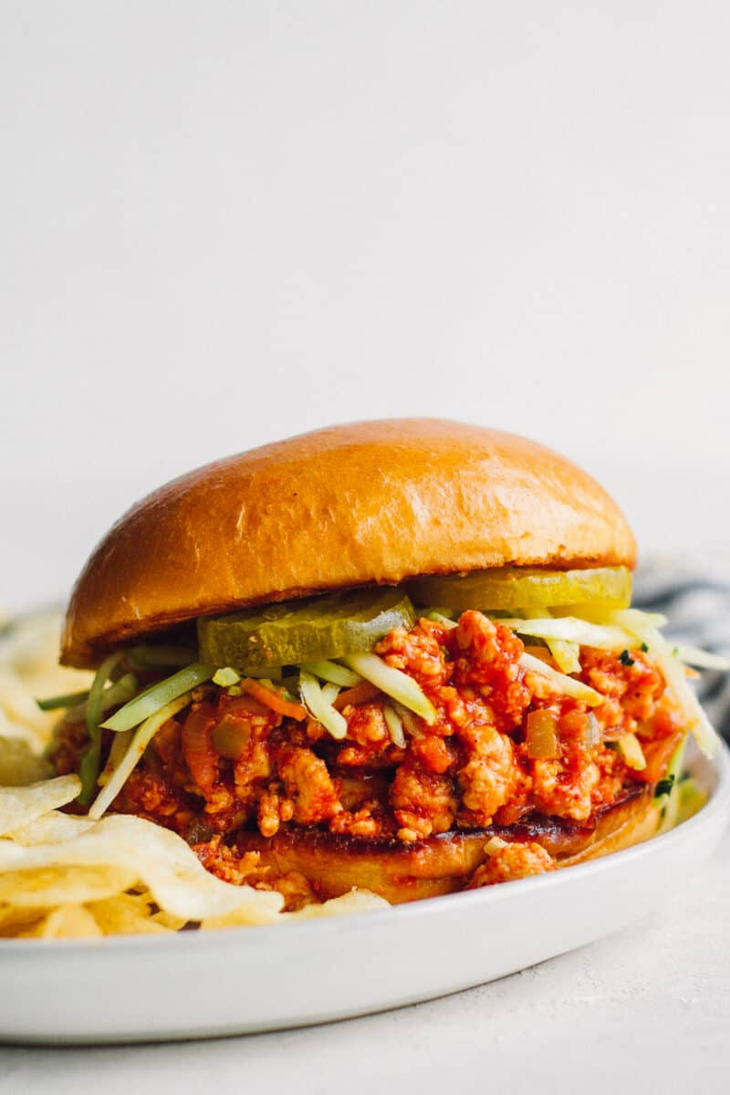 chicken sloppy joe on plate with chips