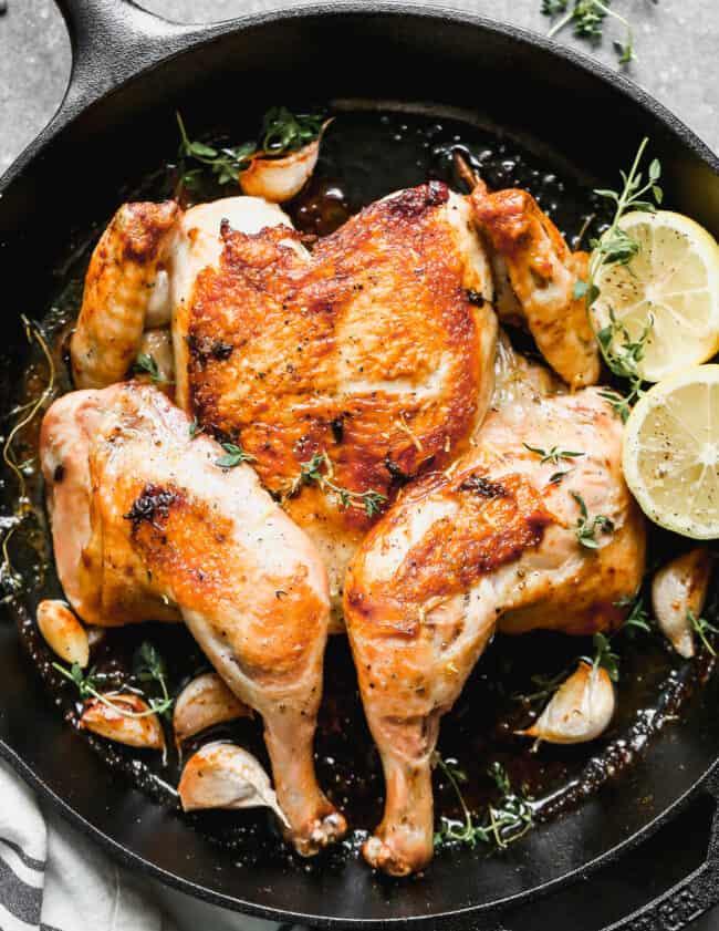 chicken under a brick cooked in skillet