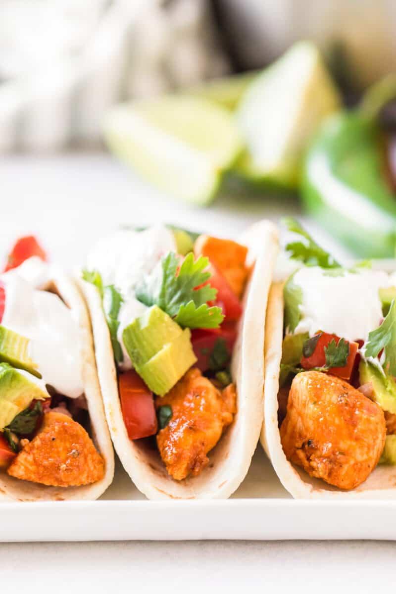 up close chicken tacos on platter