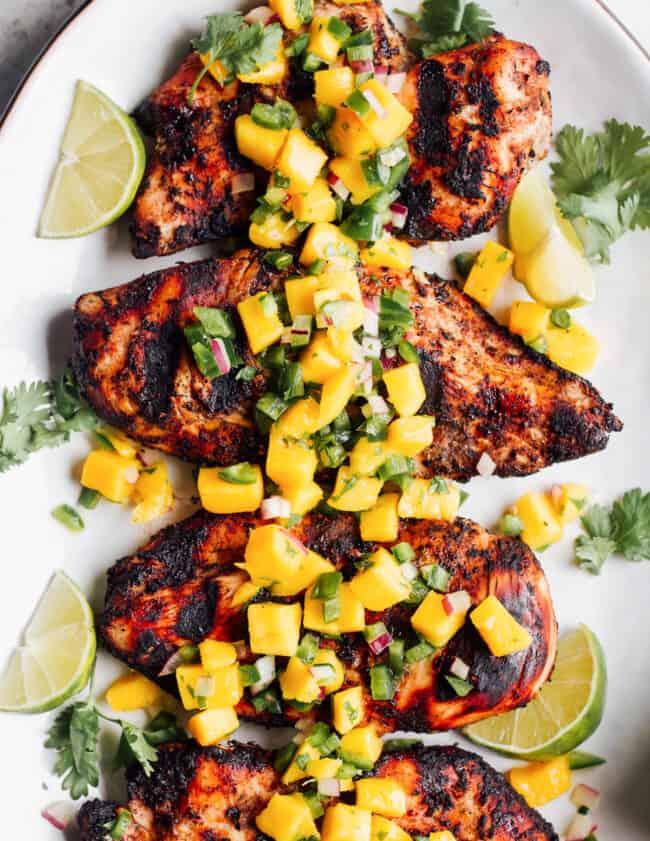 jerk chicken with pineapple salsa on platter