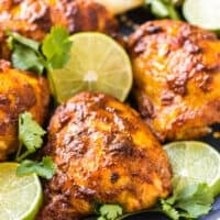 tandoori chicken on blue platter