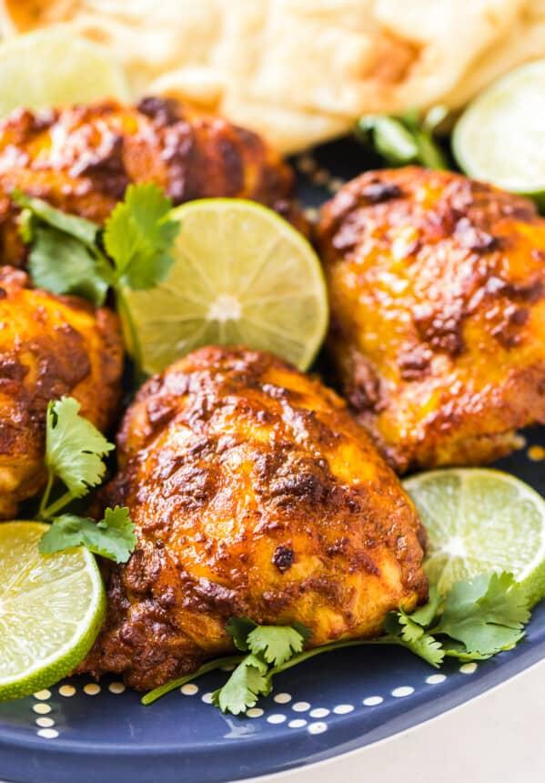 tandoori chicken on blue platter