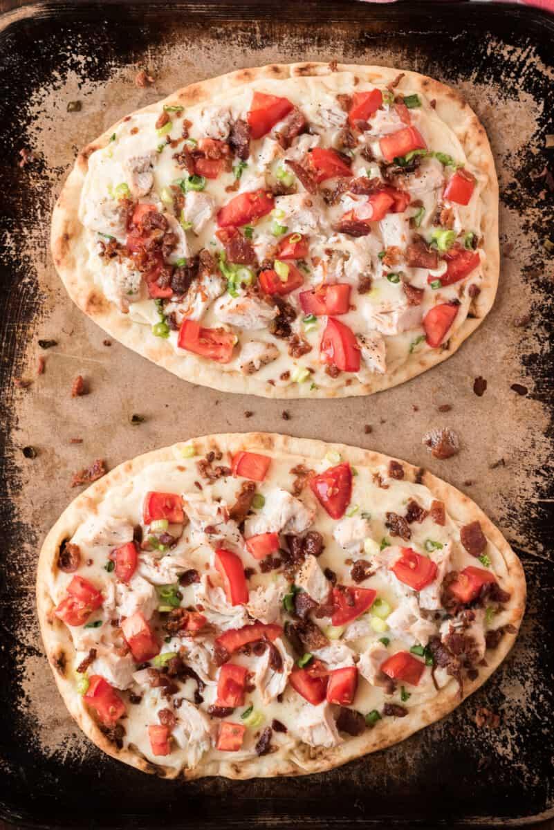 2 white chicken pizzas on sheet pan