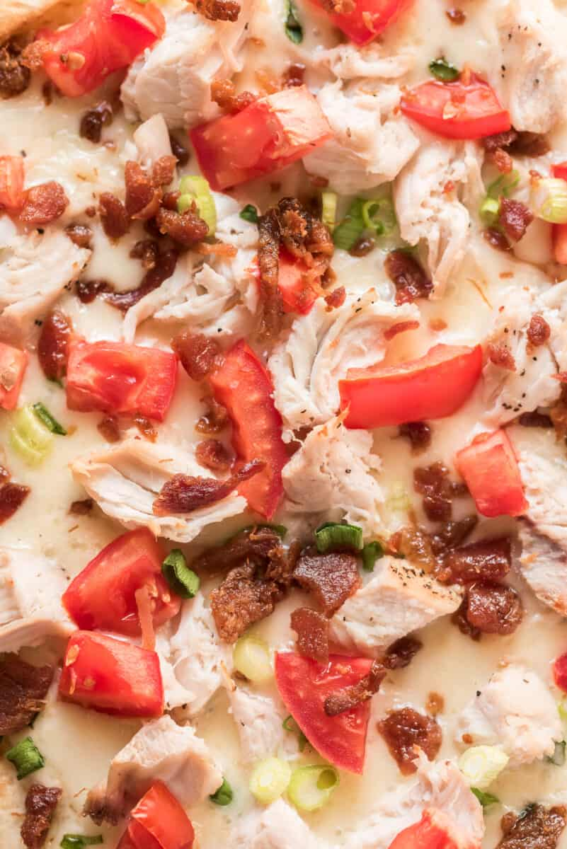 up close image of chicken pizza