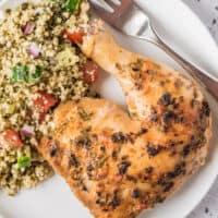 marinated chicken next to muesli on plate