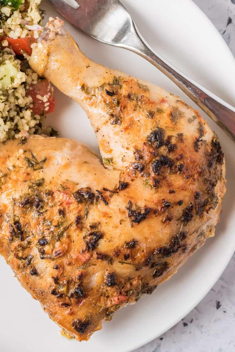 up close image of yogurt marinated chicken on plate