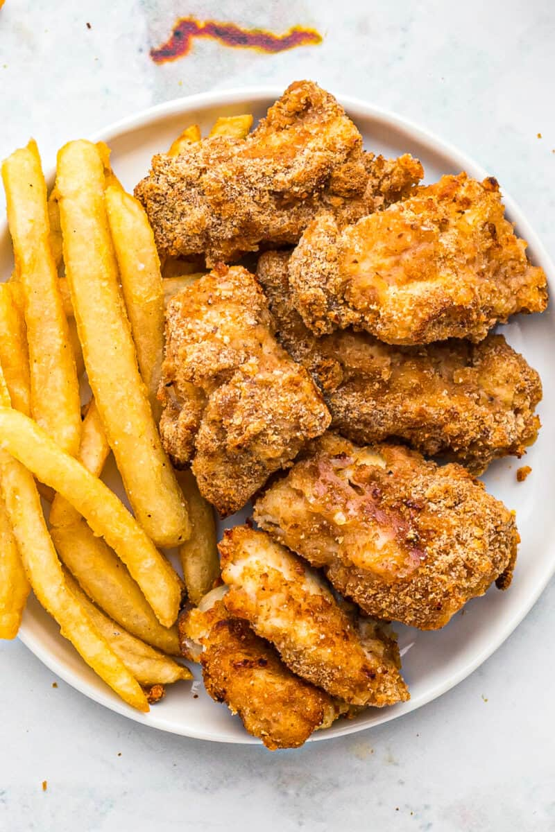 air fryer chicken nuggets with fries on plate