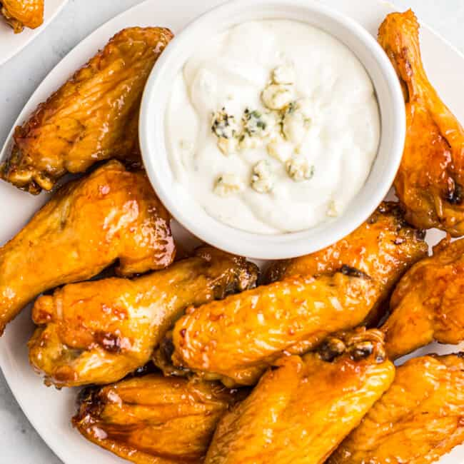 air fryer buffalo chicken wings next to blue cheese dressing