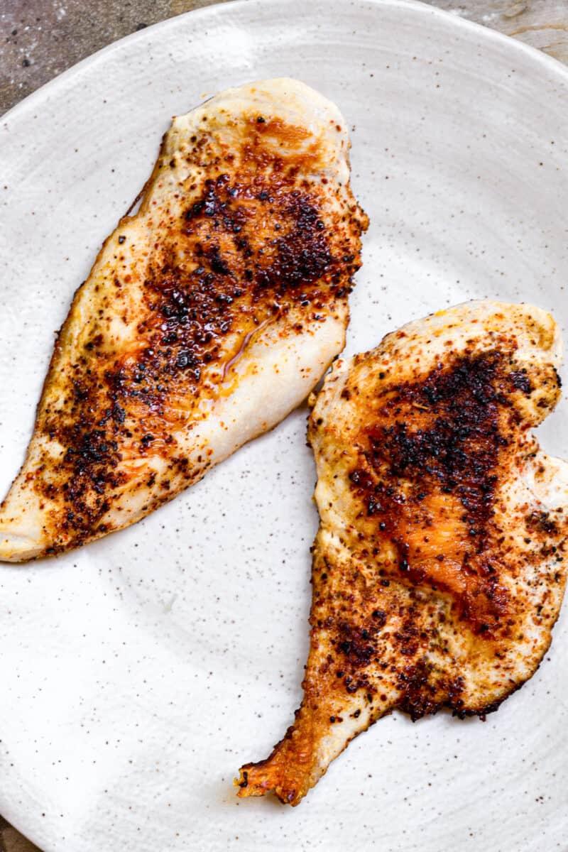 two seasoned chicken breasts