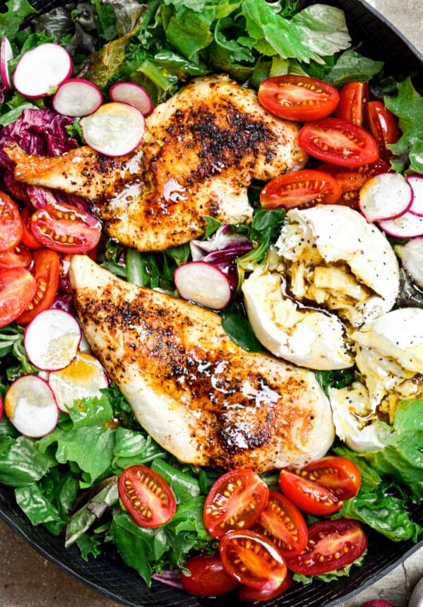 chicken burrata salad in black bowl