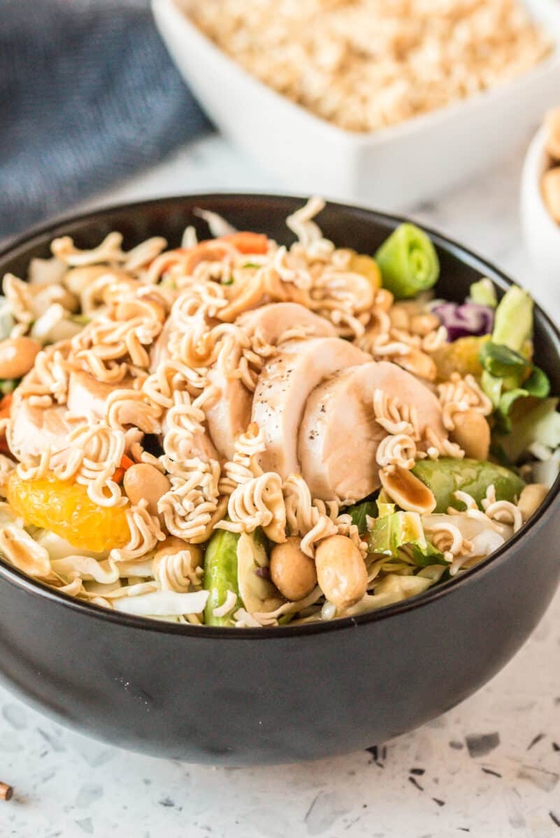 chinese chicken salad in black bowl