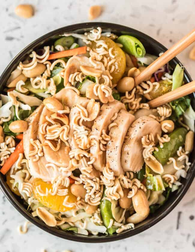 chinese chicken salad in bowl with chopsticks