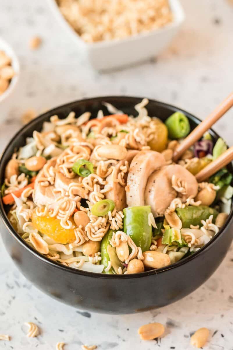 side shot of chicken salad in black bowl
