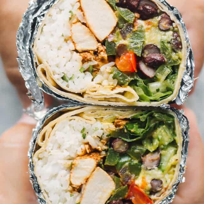 up close chipotle chicken burrito cut in half