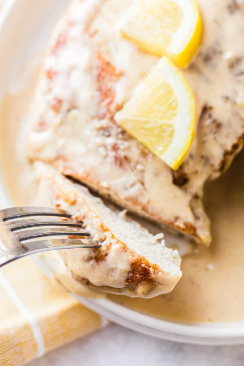 sliced lemon chicken on plate