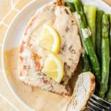 sliced lemon chicken on plate