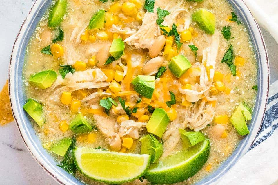 up close image of slow cooker chicken enchilada soup