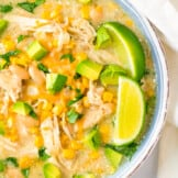 up close image of white chicken slow cooker enchilada soup