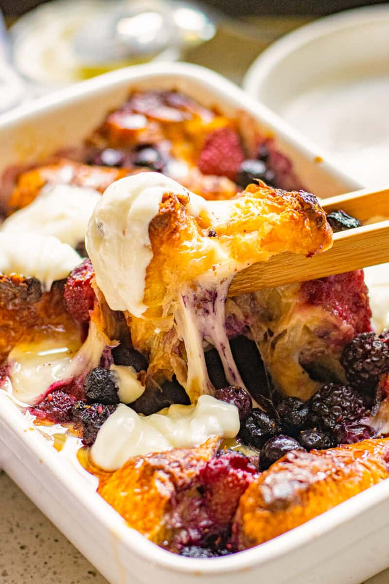 lifting up french toast casserole with cheese
