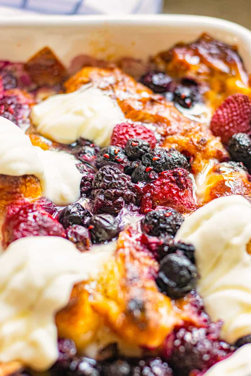 croissant french toast bake with berries and cream