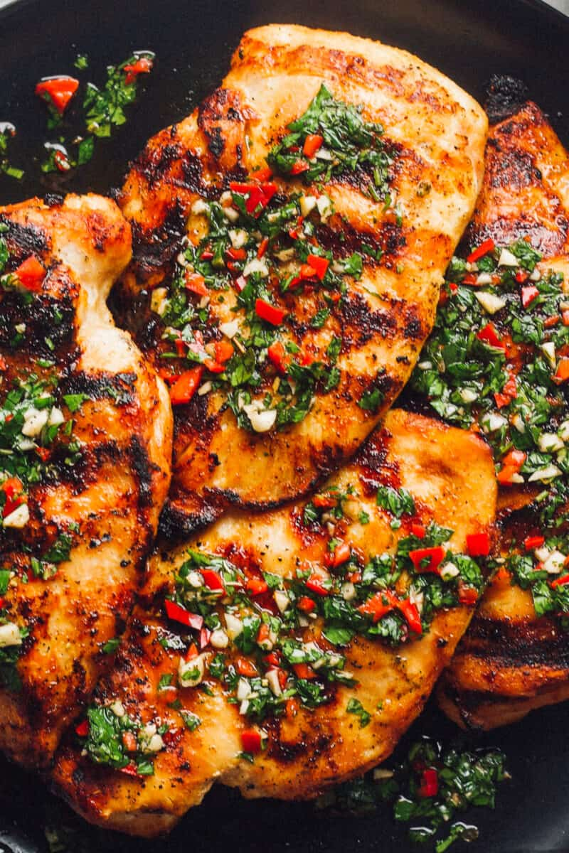 up close image of chimichurri chicken breasts on plate